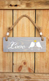 Wood sign, hanging from a rope Royalty Free Stock Image