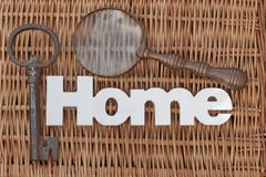 Wood Sign Home, Old Key, Vintage Magnifier On Wicker Background Stock Photo