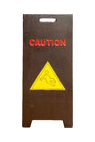 Wood sign showing warning of caution wet floor. Warning signs Royalty Free Stock Images