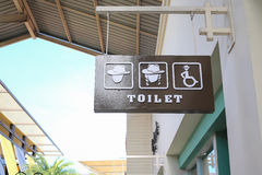 Wood sign toilet gentle gender and disabled. Royalty Free Stock Photos