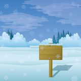 Wood sign on winter landscape Stock Photography