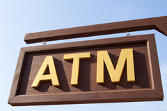 Wood signs atm Stock Photos