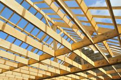 Wood skeleton of a house in construction. With blue sky royalty free stock images