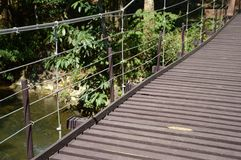 Wood sling bridge in forest Stock Photo