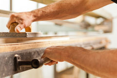 Wood smoothing with belt sander Royalty Free Stock Images