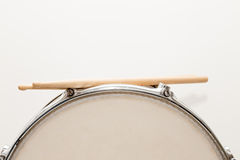 Wood snare drum and drumsticks isolated Royalty Free Stock Images