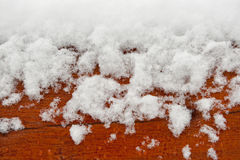Wood and snow as background Stock Photos