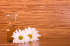 Wood spa. Spa oil, flowers on wood background Royalty Free Stock Images