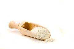 Wood spoon. With flour in it stock images
