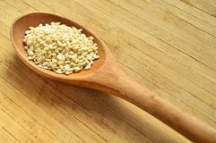 Wood spoon and raw sesame seeds Stock Photography