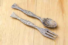 Wood spoon and folk on wood background Royalty Free Stock Photos