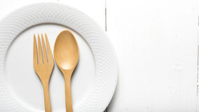 Wood spoon and fork with dish Stock Photo