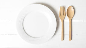 Wood spoon and fork with dish. Over white table background Stock Images