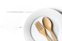 Wood spoon and fork with dish. Over white table background Royalty Free Stock Images