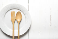 Wood spoon and fork with dish Stock Image