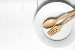 Wood spoon and fork with dish. Over white table background Stock Photography