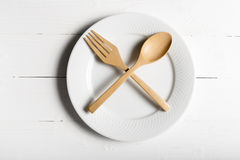 Wood spoon and fork with dish Royalty Free Stock Images