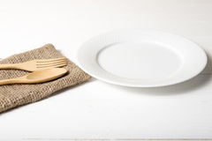 Wood spoon and fork with dish. Over white table background Stock Photo
