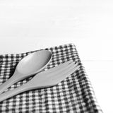 Wood spoon and fork on kitchen towel black and white tone color Stock Photography