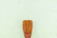 Wood spoon on green strip tablecloth,Leave space for adding your Stock Image