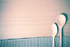 Wood spoon and kitchen towel vintage style Stock Images