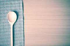 Wood spoon and kitchen towel vintage style Stock Photos