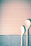 Wood spoon and kitchen towel vintage style Royalty Free Stock Images