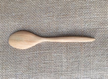 Wood spoon on natural linen background Stock Images