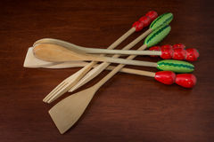 Wood spoon. Set of colored wooden spoon on a table Royalty Free Stock Image