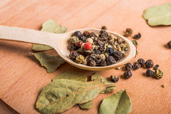 Wood spoon with spices and  bay leaves Royalty Free Stock Image