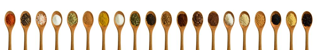 Wood spoon and various spices stock images
