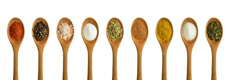 Wood spoon and various spices stock photography