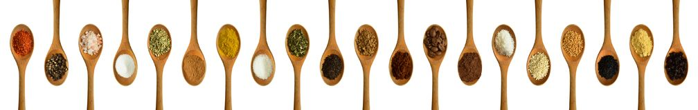 Wood spoon and various spices royalty free stock photography