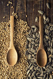 Wood spoons and grains Stock Photos
