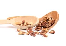 Wood spoons with walnuts and brazil nuts Royalty Free Stock Photography