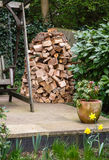 Wood stack. Circular wood stack or holz hausen with oak firewood seasoning in a garden Stock Photos