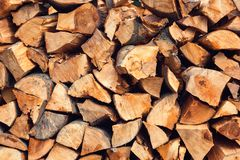 Wood Stack of chopped  firewoods prepared for winter. Wood background Stack of chopped firewoods prepared for winter Stock Photography