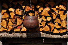 Wood stack and iron cattle. Outdoor firewood pile. Royalty Free Stock Photos