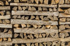 Wood stack of neatly piled firewood in the stack of crates for d royalty free stock images