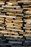 Wood stack of neatly stacked firewood and boards for drying fire. Wood, firewood, raw material, wood rental Royalty Free Stock Image