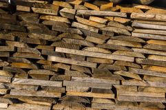 Wood stack of neatly stacked firewood and boards for drying fire. Wood, firewood, raw material, wood rental Royalty Free Stock Photography