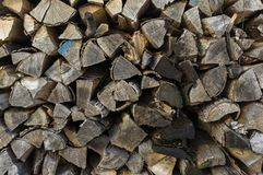 Wood stack of neatly stacked firewood and small wood to dry for. Firewood, firewood, raw material, wood rental Stock Images