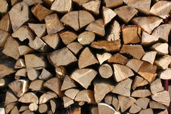 Wood stack texture. Stack of firewood in the sunlight Royalty Free Stock Images