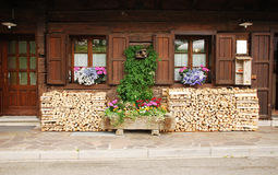 Wood Stacked Outside Village House Royalty Free Stock Images