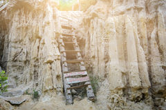 Wood stair in cave with sunlight. Solution business concept.way to success concept.Wood ladder in rock Royalty Free Stock Images