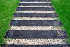 Wood stair way on green garden Stock Image