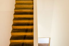 Wood steps. Wood staircase of duplex building leading to attic stock image