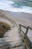 Wood stairs on the beach. On the beach of Black Sea, old wood stairs, going down to water Royalty Free Stock Photo
