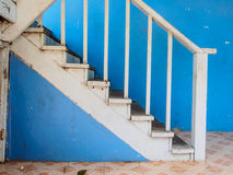 Wood stairs and blue wall Stock Photos