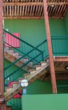 Wood Stairs on Green Stucco Stock Photos